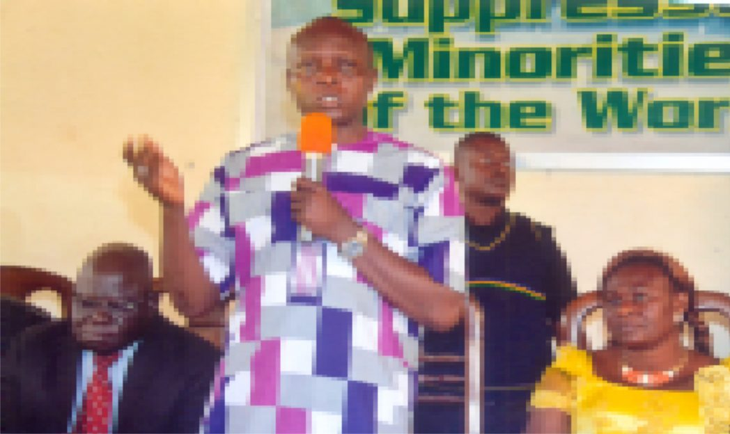 Chairman, Caretaker Committee, Khana Local Government Area of Rivers State, Hon. Gordon Tornwe (standing), addressing the people at the inuguration of his caretaker committee members in Bori recently. With him are Justice A. A. Ebe of the Bori High Court (left) and wife of the CTC Chairman, Mrs Tornwe wife of CTC Chairman.. Photo: Chris Monyanaga