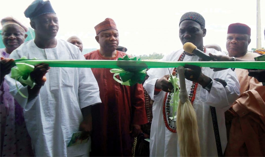 Olomu Of Omu-Aran, Oba Charles Ibitoye (middle), Chairman, Irepodun Local Government Area, Mr Luqman Owolewa and other officials, at the inauguration of a Gari Processing Plant in Omu-Aran, Kwara, recently.