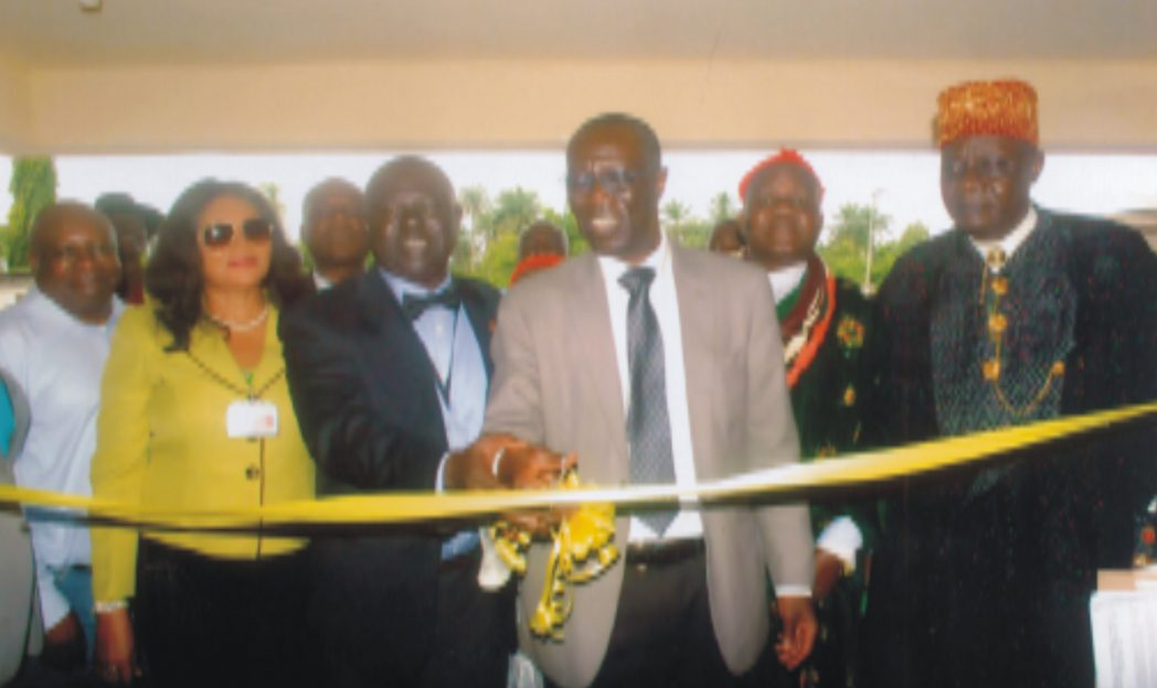 Manager, Occupational Health, Mobil Producing Nigeria, Dr. Ayozele Fagbemi (3rd right) cutting a tape  for official commissioning of completed project at FAAN medical centre at Port Harcourt Int'l Airport, Omagwa. With him are Regional General Manager, FAAN, Mrs. Ebele Lagos, Dr. Oduwole Wale (2nd left), Paramount Ruler Igwuruta, HRH. Eze Prof. Samuel N. Wekhe, recently. Poto: Egberi A. Sampson