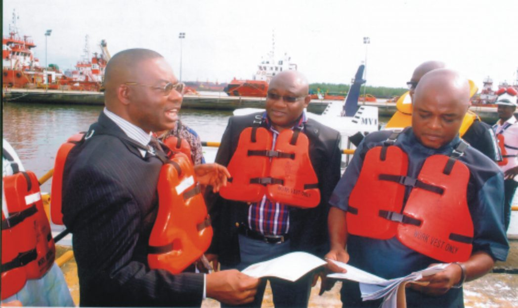 L-R: General Manager, SDCR, Shell Pet. Dev. Company of Nig. Ltd., Mr. Nezo Osayande, Government and Communities Relations, MGR, Bayelsa and Delta, Mr. Evans Krukrubo, with chiarman, Agbidiama CTC, Hon. Emmanuel Fungewei, during the commissioning of Agbidiama landing craft at SPDC Marine Base, Kidney Island, Port Harcourt, recently. Photo: Egberi A. Sampson