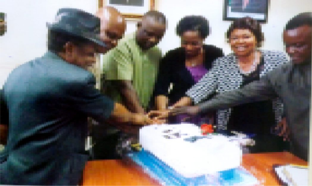 Rivers State Commissioner for Employment Generation and Empowerment, Dr. Ipalibo Harry (3rd left) cutting his birthday cake with the Permanent Secretary and the management staff in Port Harcourt recently.