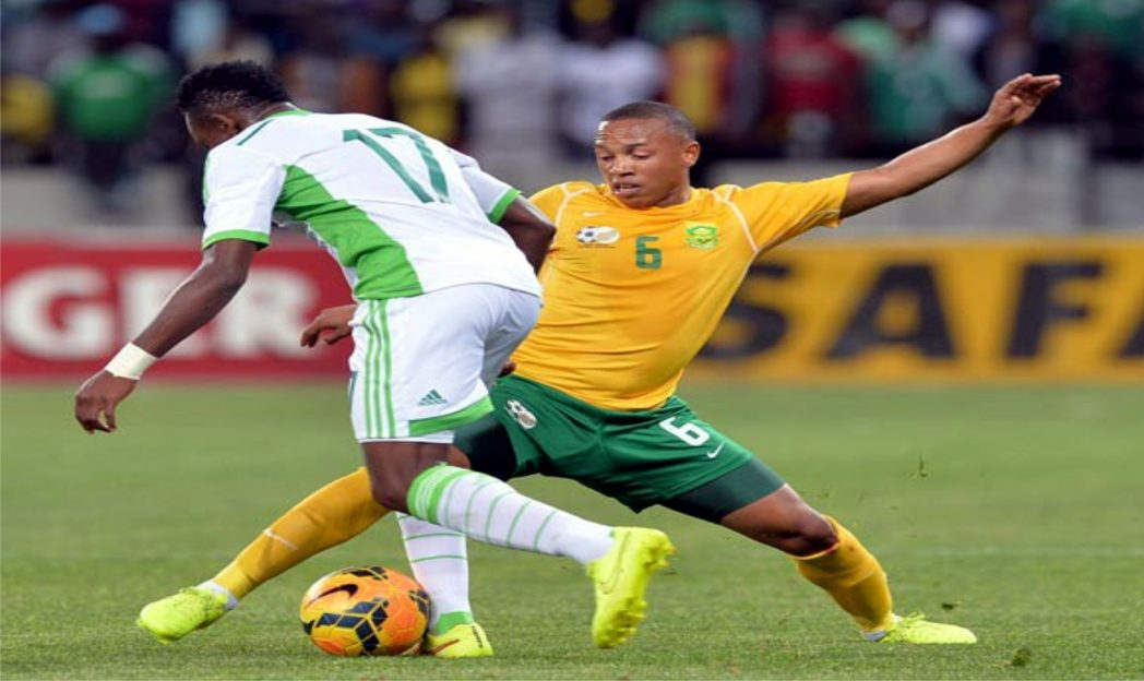 A South African midfielder (6) in contest with Nigeria's Onazi Ogenyi when the two countries clashed in a 2015 AFCON Qualifier last month.