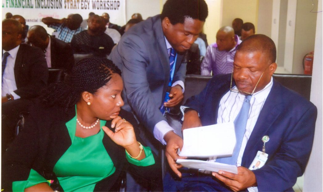 Head Financial Inclusion, Mrs Akin-Fadeyi, CBN Secretariat, Temitope (left), with Corporate Communication Officer, CBN, Mr Obinali Okoli (middle) and Assistant Director, CBN Mr Eze Okone, during the workshop on Financial Inclusion by the CBN at Port Harcourt CBN  branch on Tuesday 14 October 2014. Photo: Chris Monyanaga