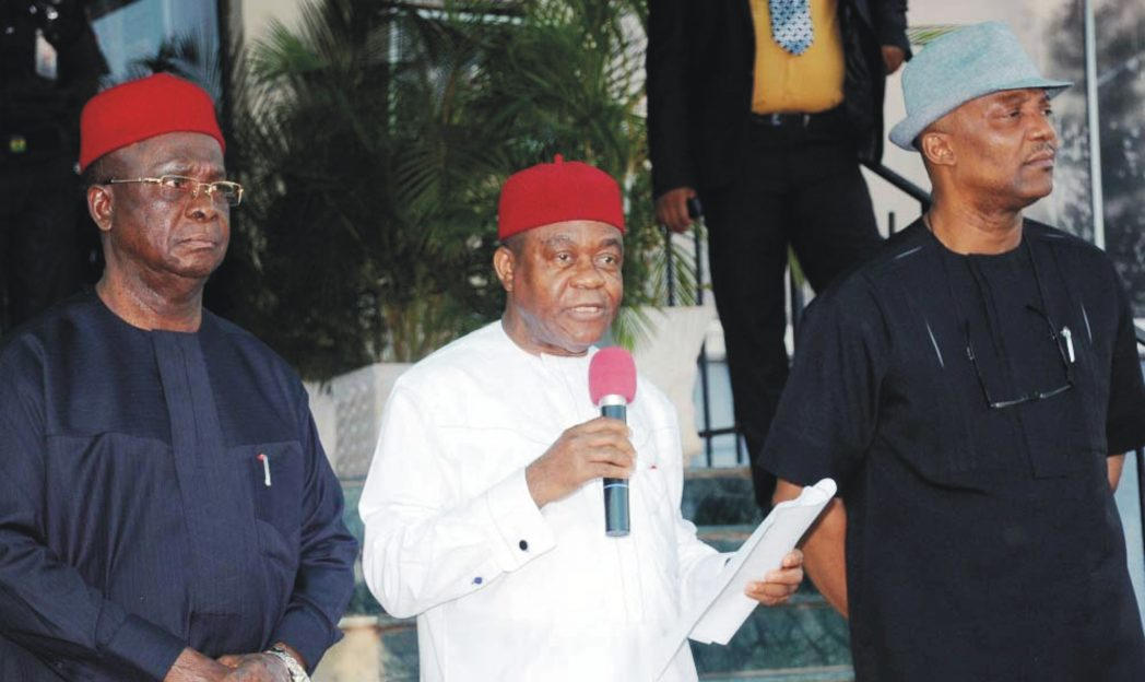 L-R: Governors Martin Elechi of Ebonyi, Theodore Orji of Abia State and Anambra State Deputy Governor, Nkem Okeke, addressing newsmen after the South-East Governors Forum in Enugu, recently. Photo: NAN