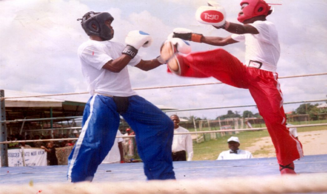 Kickboxers struggling for honour during  a sports event in Port Harcourt recently.
