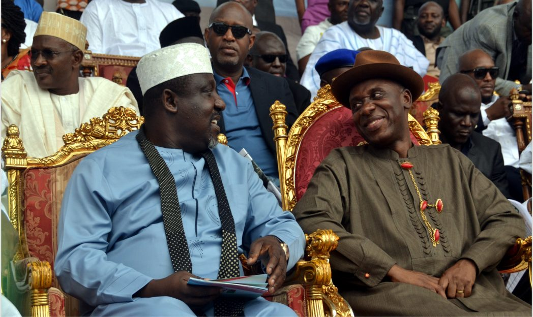 Rivers State Governor, Chibuike Amaechi (right), conferring with his Imo State counterpart, Governor Rochas Okorocha, during the APC Rivers Mega Rally at Igwuruta -Ali, Greater Port Harcourt City, last Saturday