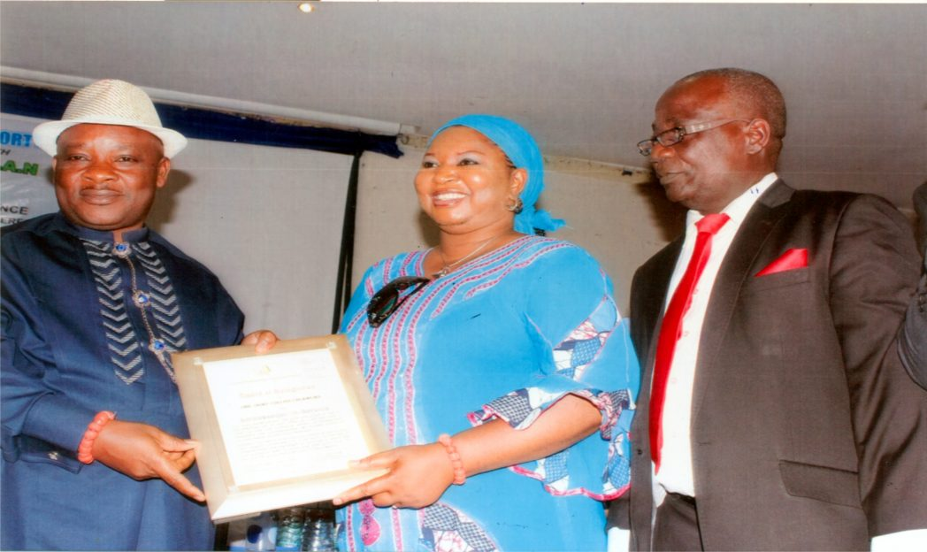 Nye Nwe-Eli and Paramount Ruler of Rukpokwu, HRH. Eze (Dr) Collions C. Ogwu III (left), posing with his Ambassador Award. With him is his wife, Lady Beatrice Ogwu and President, Church Management Suppport Ministry, Dr Kayode Nissi, during the 2014 National Conference, recently. Photo: Egberi A. Sampson