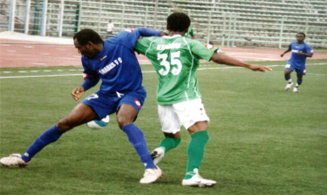 Sharks and Dolphins players struggling for honour during a league match in Port Harcourt recently