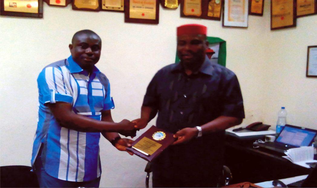 Rivers State SWAN Chairman, Honour Sirawo (left), presenting the award to Oziegbe
