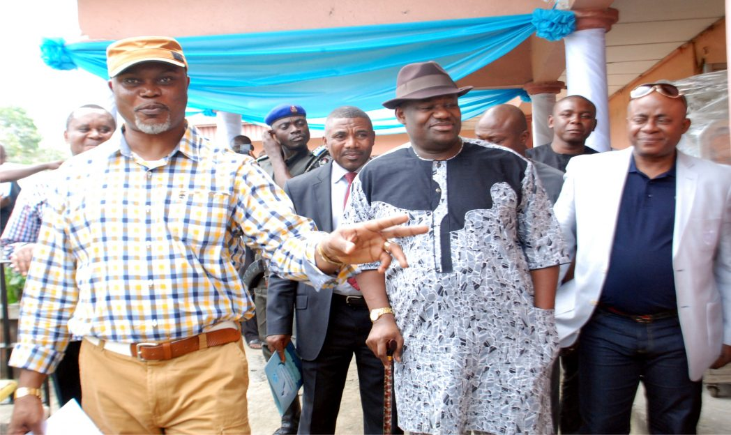 Rivers State Dep Gov, Engr. Tele Ikuru (centre) listens as Commissioner for Commerce and Industry, Barr. Chuma Chinye, explains functions of some equipment for distribution (2).