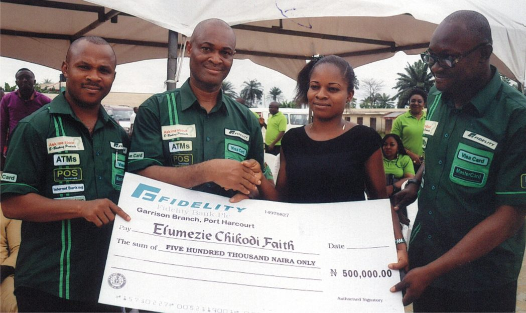 Mazi Charles Okoro, (2nd left) Regional Bank Head of Fidelity Bank South-South in a handshake congratulating Miss Faith Elumezie Chikodi one of the winners of the Fidelity Save for Scholarship promo organised by the bank  in Port Harcourt, recently. Flanked (right) Anthony Onah, Head SME Rivers/Bayelsa Region and Uchenna Oparah Head of e-banking/sales.