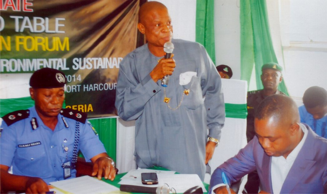 Rivers State Director, National Orientation Agency, Mr Oliver Wolugbom (middle) delivering an address, during the 14th Rivers State NOA roundtable, in Port Harcourt, recently. With him are Sole Administrator, Rivers Waste Management Agency, Mr Ade Adeogun (right) and a police officer. Photo: Prince Obinna Dele