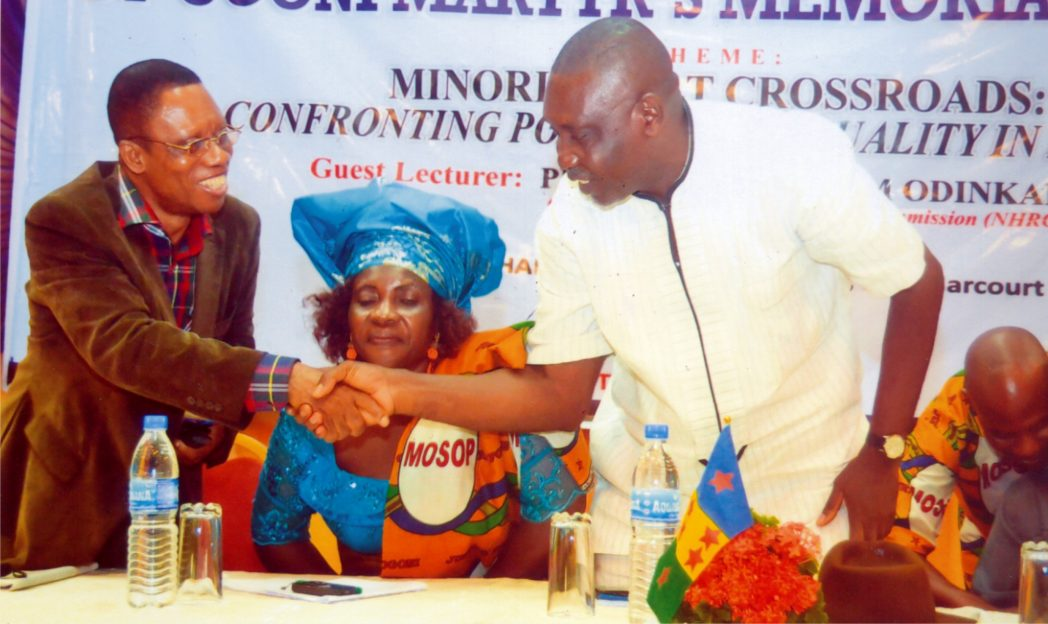 Chairman of the Occasion, Chief Amaechi Ogbona (right) in a handshake with one of the Guest Lecturers, Prof Ben Naanen at the 19th Ogoni Martyrs Memorial Lecture organised by MOSOP in Port Harcourt, recently. Photo: Chris Monyanaga