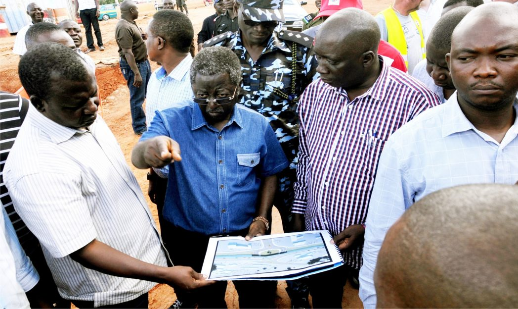 Gov. Jonah Jang of  Plateau (2nd left), going through a plan of a  Bridge at the Secretariat junction, Yakubu Gowon way, during  inspection of road projects in Jos recently.
