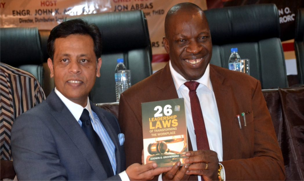 The Author of 26 Leadership Laws of A Workplace, Dr Godwin O. Orovwiroro (right), with Chief Executive Officer, PHED, Mr John Abbas, displaying a copy of the book shortly after its unveiling at Sasun Hotel, Port Harcourt, last Friday.
