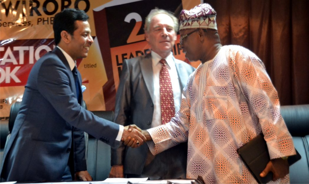 Chief Damian Okolie (right), welcoming the CEO, PHEC, Mr John Abbas (left) to the launch of 26 Leadership Laws Of A Workplace, recently, in Port Harcourt. With them is PHED Chief Financial Officer, Mr Jean Piere Brethon. Photo: Nwiueh Donatus Ken