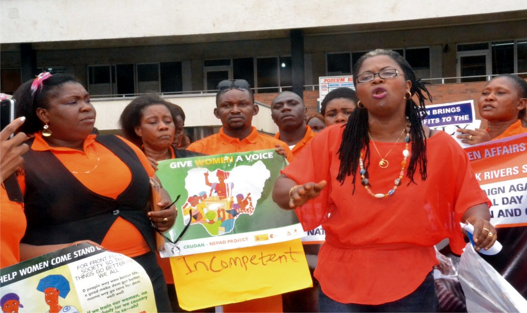 Mrs Lilian Okonkwo, (right) Chairman, NAWOJ, Rivers State chpater, addressing guests at a road walk to mark International Day for the Elimination  of Violence Against Women in Port Harcourt, recently.    Photo: Ibioye Diama