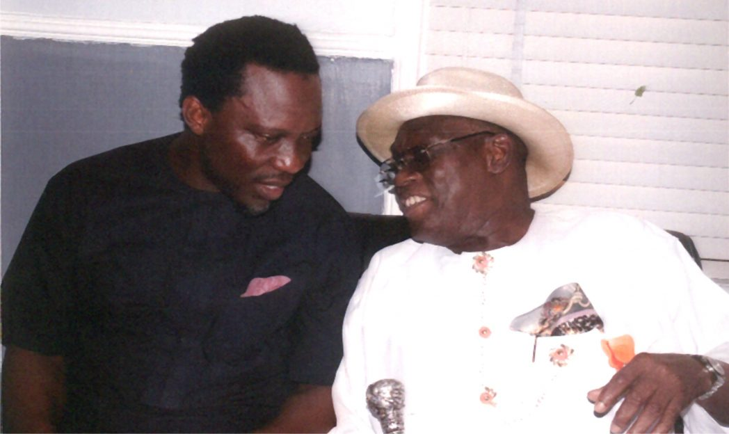 Member, Rivers State House of Assembly and House of Representatives aspirant for Degema/Bonny Federal Constituency, Hon. Aye Atamah Pepple (left) in a chat with Chairman, Rivers State Civil Service Commission, Sir, Ngo Elekima Martyns-Yellowe (right) during St. Andrew's Anglican Church, Bakana, 2014 Adult Harvest Thanksiging Service last Sunday. Photo: Egberi A. Sampson