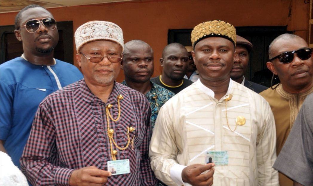 APC Governorship candidate in Rivers State, Hon. Dakuku Peterside (right) and member of the Party's Board of Trustees, Dr. Sam Sam Jaja (left) display their Permanent Voter's Cards after collection in Opobo Town, Rivers State, last Saturday.