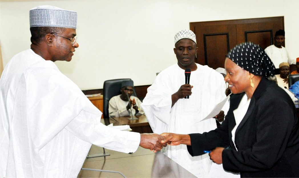 Governor Isa Yuguda of Bauchi State (left), congratulating the new State Chief Judge, Justice Talatu Umarm, during her swearing-in in Bauchi recently. Photo: NAN
