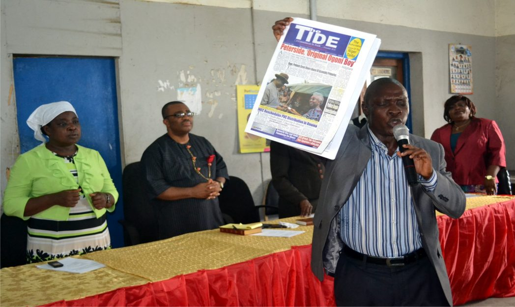 Pastor, Mountain of Fire Ministry, Hanson N. Cleophas (2nd right) dedicating The Tide Newspaper during the 43rd Anniversary of Rivers State Newspaper Corporation (RSNC) yesterday, at the corporation's commercial hall. With him are the Director of Admin. Emi Jameson (left), General Manager, (RSNC), Mr Celestine Ogolo and Director, Publications, Mrs. Juliet Njiowhor (right).  Photo: Nwiueh Donatus Ken