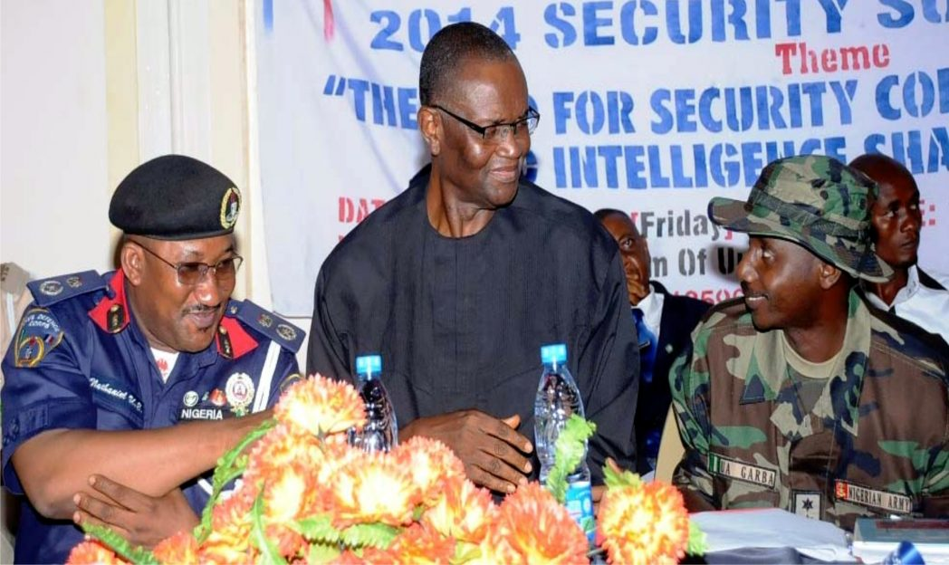 L-R: Commandant, Nigeria Security and Civil Defence Corps (Nscdc), Enugu State, Mr Nathaniel Ubong, Representative of Enugu State Government, Mr Chime Richard and representative of Commandant,  Nigerian Army 82 Garrison, Capt. Umar Garba, at the Nscdc 2014 Security Summit in Enugu, recently.