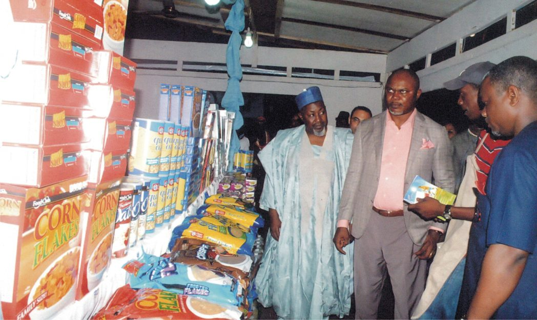 Commissioner for Commerce Rivers State, Hon. Chuma C. Chinye representing Governor of Rivers State Rt. Hon. Chibuike Rotimi Amaechi (middle) inspecting some business stand. With him, National President NACCIMA Alhaji Mohammed Bodaru Abubakar (left) and Chairman, Port Harcourt International Trade Fair, Chief Allison Ogidiben at the official opening ceremony of 9th Port Harcourt Trade Fair at Isaac Boro Park, recently. Photo: Egberi A. Sampson