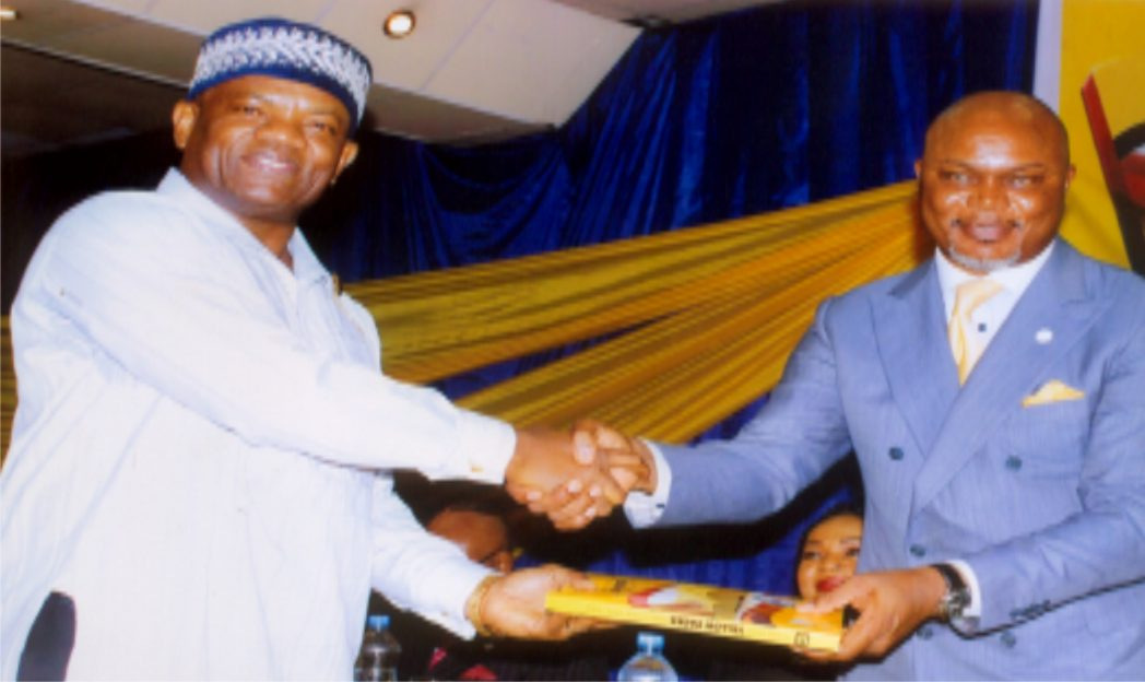 Rivers State Commissioner for Commerce and Industry, Hon. Chuma C. Chinye (right) in handshake with  Administrative Director, MCC, Mr Nelson Jaja (left) at the public presentation of the Yellow Pages Directory organised by Ministry of Commerce and Industry in Portr Harcourt. Photo: Egberi .A. Sampson