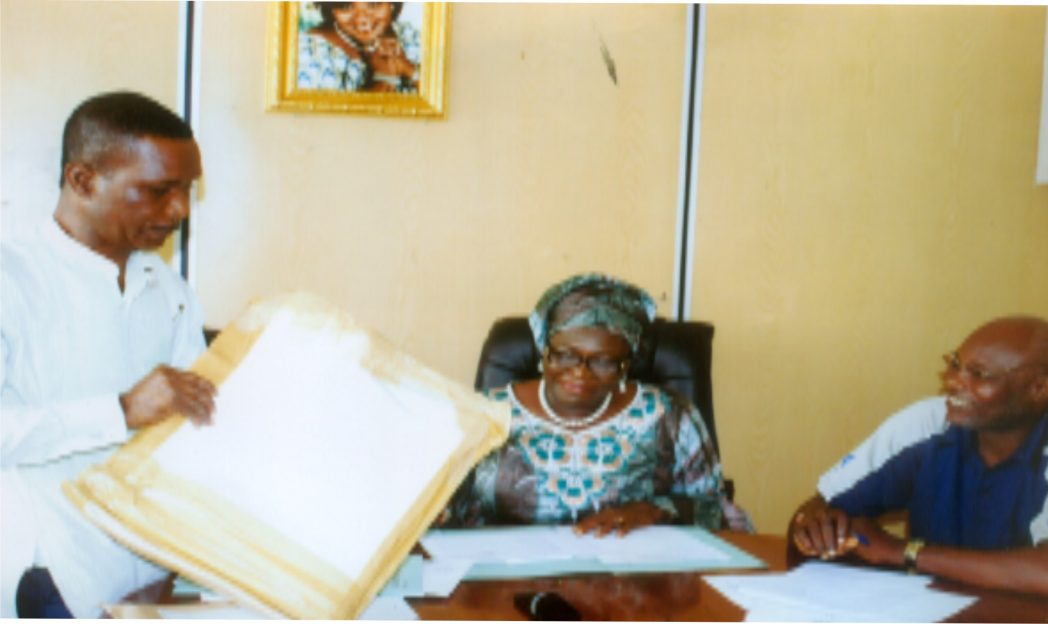 Director of Ministry of Information and Communications Mr. Rufus Direh (left) opening an envelop of the sample duirng the bidding of 2015 Calender/Diaries at the ministry recently. With him are Permanent Secretary of the ministry, Mrs Cordelia Peterside (middle) and Director, Administration, Mr. Hawkin's T. Ide. Photo: Egberi A. Sampson