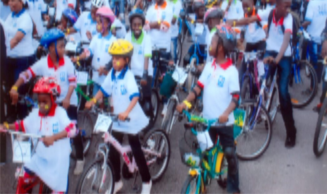 Cross section of youths cycling with the Rivers State Commissioner for Youth Development, Sir Owene Wonodi during a road show on cancer awareness in Port Harcourt