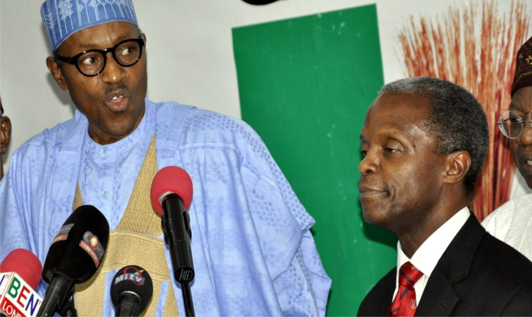 All Progressives Congress Presidential candidate for the 2015 General Election, Gen. Muhammadu Buhari (rtd) introducing his running mate, Prof Yemi Osinbajo (right) at a media briefing in Lagos, yesterday.