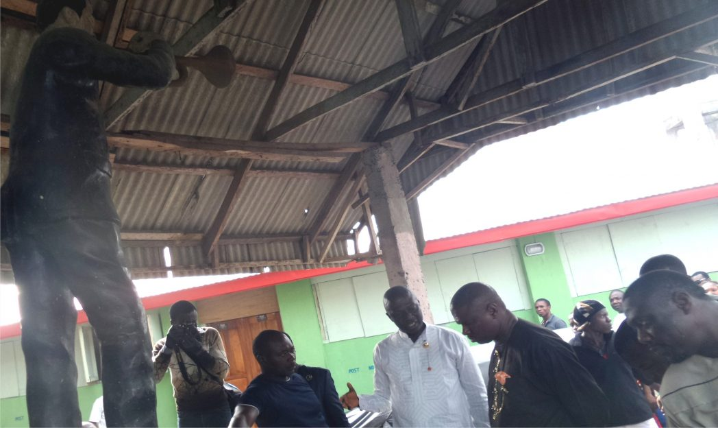 Dr. Dawari George (3rd left) briefing Dr. Peterside (2nd right) at the mausoleum of Cardinal Rex Jim Lawson, while Hon. Ojukaye Flag-Amachree, (1st right) listens