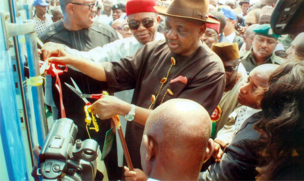 Vice President Nemadi Sambo cutting the tap at the official commissioning of Enugu-Port Harcourt rail line. With him are Abia State Governor, Theodore Orji (2nd left) and former Anambra State Governor, Peter Obi (left).