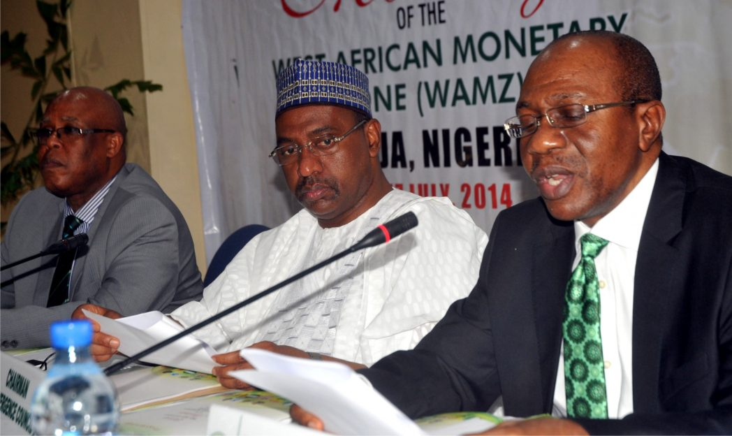 L-R:  Director-General, West African Monetary Institute, Mr Abwaku Englama, Chairman, Convergence Council, Amb. Bashir Yuguda and Chairman, Committee of Governors, Mr Godwin Emefiele, during the 2014 Mid Year Statutory Meeting of  West African Monetary Zone in Abuja, recently.