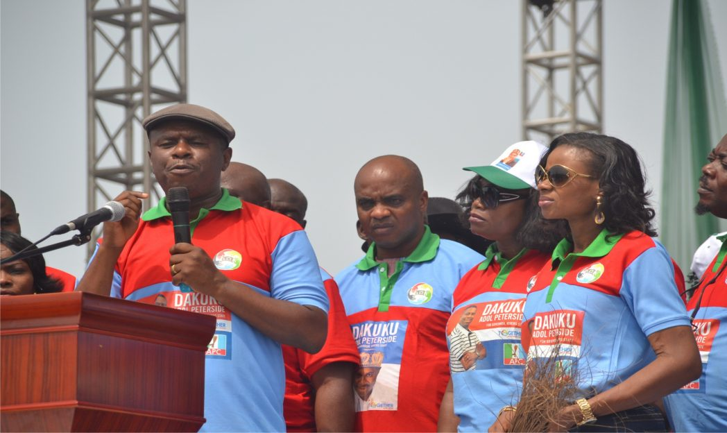 Hon Dakuku Peterside (left) APC governorship candidate addressing party supporters at the flag off of his campaign rally at the Liberation Stadium in Port Harcourt recently. Photo: Ibioye Diama