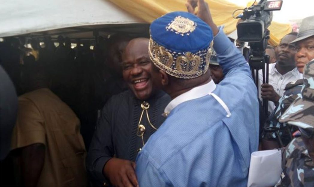 APC Governorship candidate, Dr Dakuku Peterside and his PDP counterpart, Chief Ezebunwo Nyesom Wike exchanging pleasantaries at the MOSPOP celebration of Ogoni Day at Bori, headquarters of Khana Local Government Area, Rivers State, yesterday.