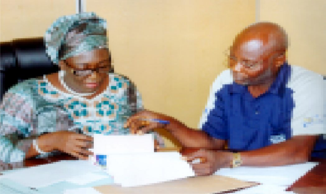Permanent  Secretary, Ministry of Information & Communications, Rivers State, Mrs Cordelia Peterside (left) with Director Admin of the Ministry,  Hawkin's T. Ide (right) in the bidding of the 2015 Calender / Diaries at the ministry recently. Photo: Egberi A. Sampson