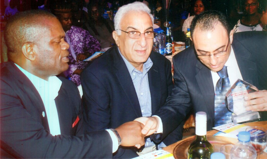 Executive Director, MCC Nigeria Ltd, Mr Nelson Jaja (left) having a handshake with Chief Nabil Saleh in the Garden City Corporate Award, organised by the Minister of Commerce and Industry in Port Harcourt, recently.