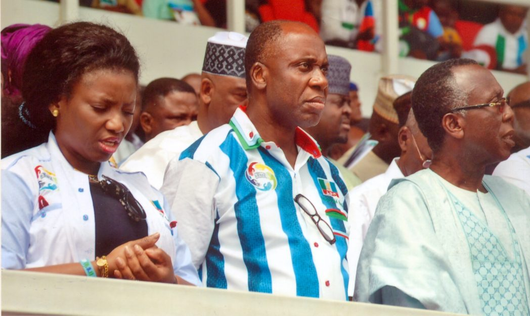 Rivers State Governor, Rt. Hon. Chibuike Rotimi Amaechi (middle), his wife, Dame Judith Amaechi, and former PDP National Chairman, Audu Ogbe at the APC presidential campaign flag-off in Rivers State, yesterday.