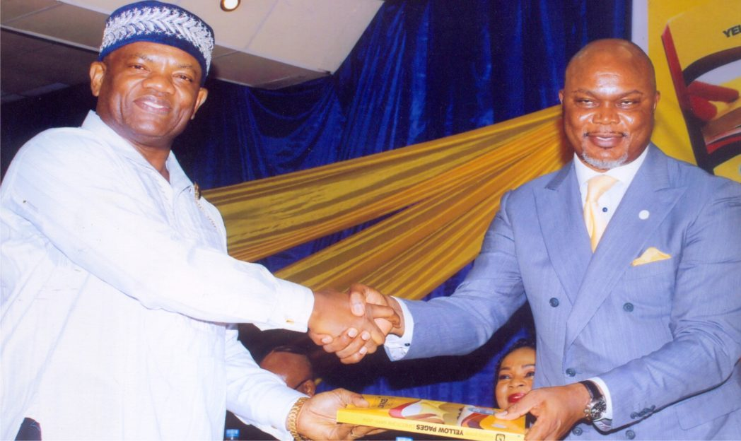 Rivers State Commissioner for Commerce and Industry, Hon. Chuma C. Chinye (right) in handshake with Administrative Director MCC, Mr. Nelson Jaja (left) in the public presentation of the Yellow Pages Directory, orgnaised by Ministry of Commerce and Industry in Port Harcourt recently. Photo: Egberi A. Sampson