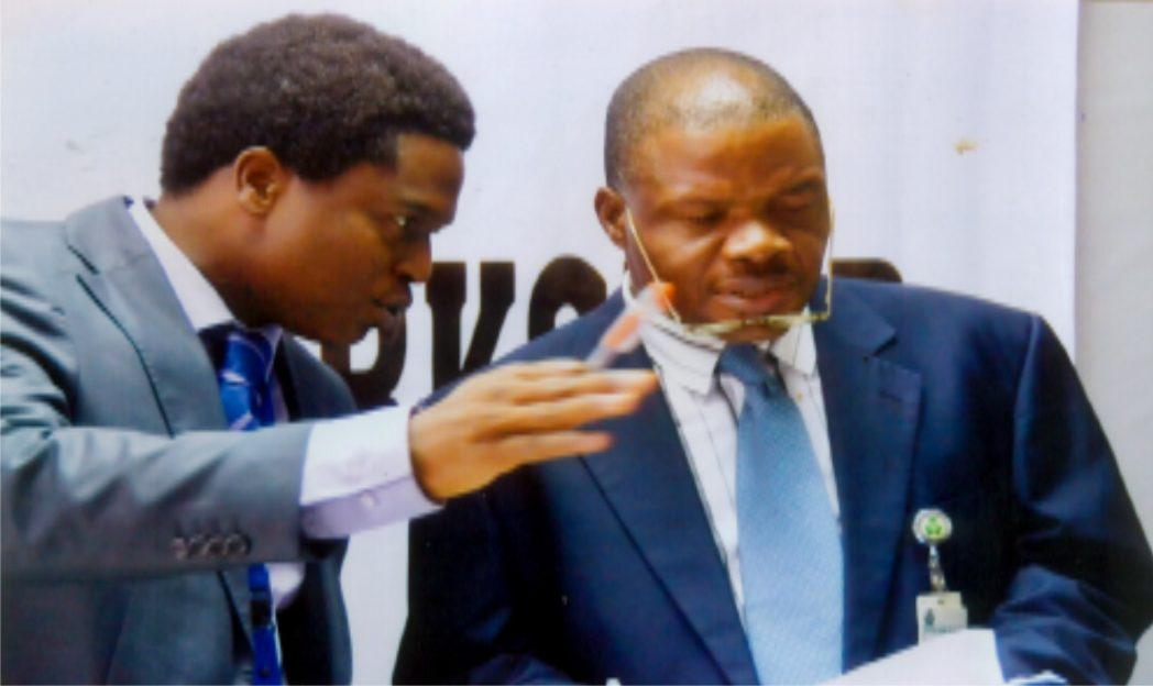Assistant Director, Central Bank of Nigeria (CBN), Mr Eze Okone (right) listening to the corpoorate communication officer CBN, Mr Obinali Okoli (left) during the workshop on CBN Financial Inclusion secretariate at CBN Port Harcourt branch recently. Photo: Chris Monyanaga.