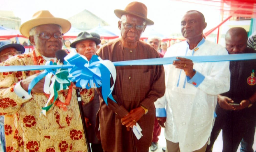 HRH Emmanuel Obudibo, (JP) (left) Amayanabo of Ogoloma, cut the tape to commission an ultramodern market built by Hon Belema Okpokiri, member Rivers State House of Assembly representing Okrika Constituency (right)  and Chief  (Sir) E. A. G. Inimgbatuboni (middle) Head Chief  of Amadi Town, Port Harcourt.                          Photo: Ibioye Diama