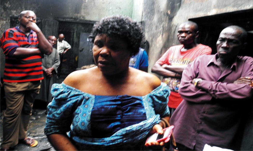 Villagers sympathizing with Mrs Francisca Adumanu, a widow from Umuchoke village in Obazu Mbieri autonomous community in Imo State whose house and properties were set ablaze by unknown persons
