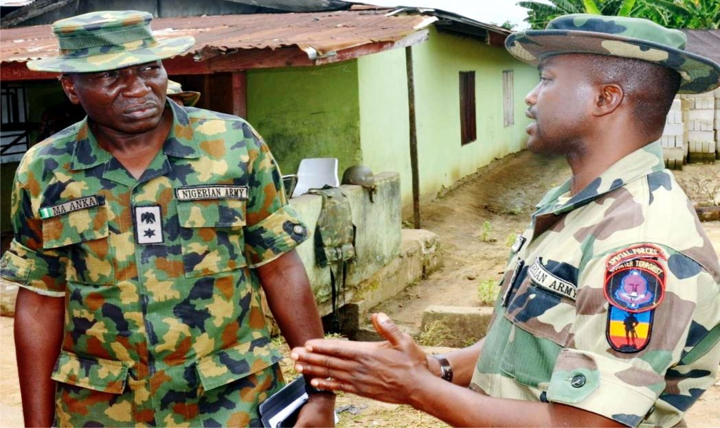 Media Coordinator, Joint Task Force, LT Col. Mustapha Anka (left), with the Commander of the troops deployed to Ibaa community, Capt. M. Yahaya, after a violent clash between two cult groups, which sacked residents of the community in Rivers State recently.