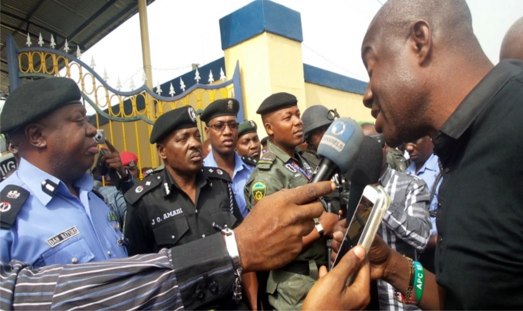 Chief of Staff, Government House, Port Harcourt and House of Representatives candidate for the All Progressives Congress (APC) in Obio/Akpor, Sir Tony Okocha (right) addressing the Rivers State Police Commissioner, Dan Bature (left) and top police officers on the grievances of APC in the area, last Monday.