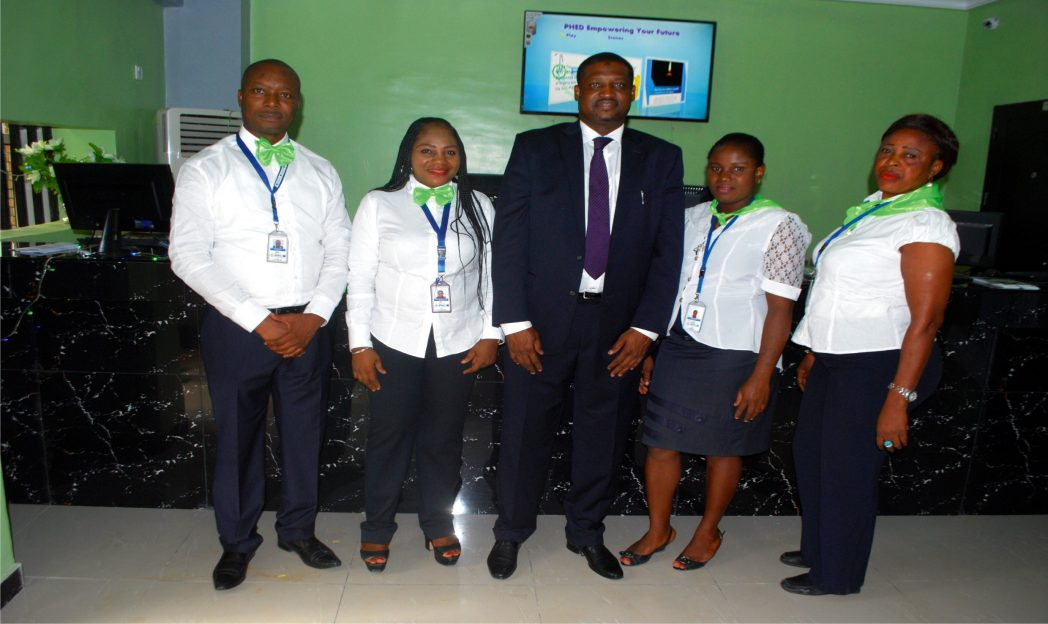 Dr Abba Ibrahim with the staff of PHED after commissioning of the new customers' centre in Port Harcourt, recently.