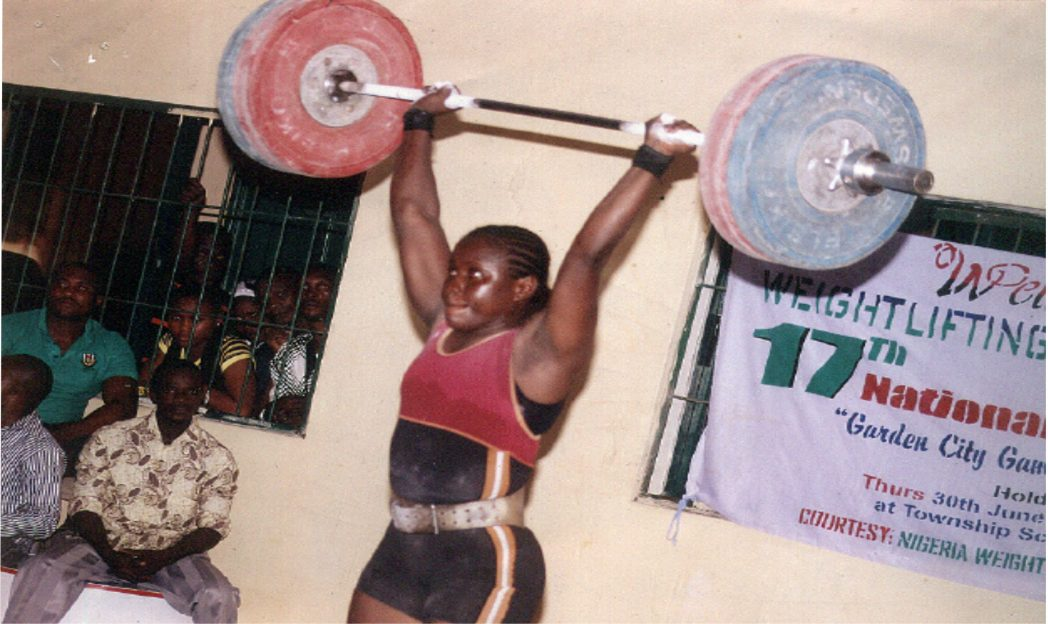 A  female weightlifter showing her skills during a previous National Sports Festival