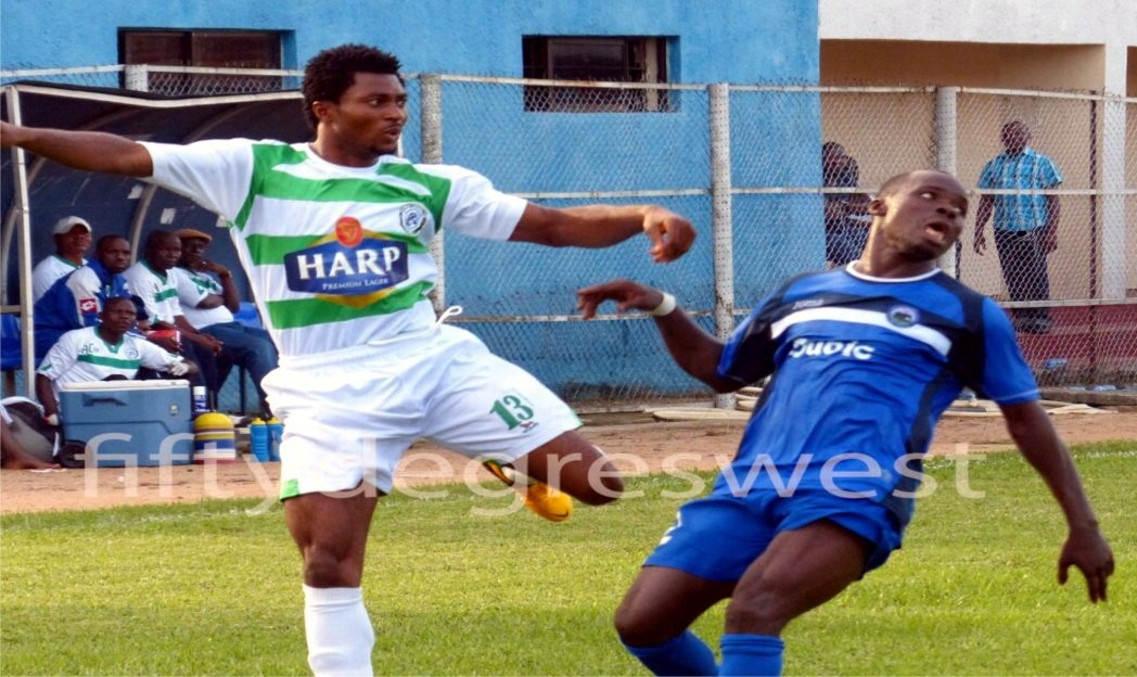Dolphin FC player trying to outsmart opponent during premier match recently.