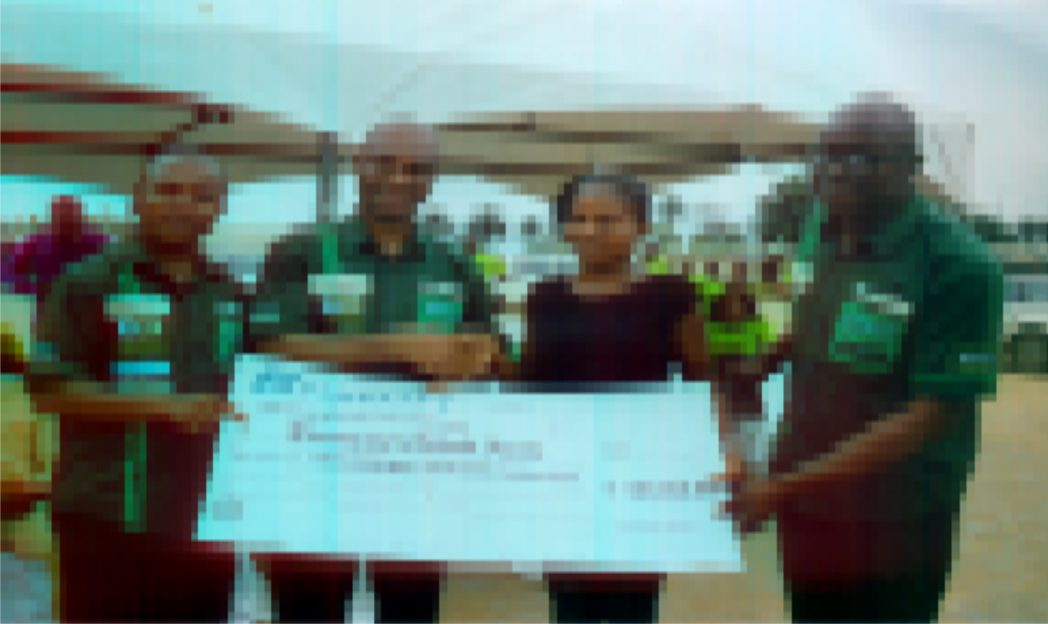 Mazi Charles Okoro (2nd left) Regional Banker/Head of Fidelity Bank South-South in a handshake congratulating Miss Faith Chikodi Elumezie, one of the winners of the Fidelity Save for Scholarship at a promo organised by the bank in Port Harcourt, flanked are Uchenna Opara, Head of e-banking/Sales and Anthony Onah, Head SME, Rivers/Bayelsa region. Photo: Ibioye Diama