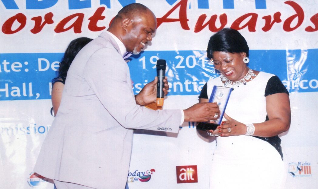 Rivers State Commissioner for Commerce and Industry, Hon Chuma C. Chinye (left) presenting an award to the Vice Chairman, Moni Pulo, Mrs Seinye Lulu Briggs, during Garden City Corporate Awards, organised by the Ministry of Commerce and Industry, Port Harcourt.                                                                               Photo: Egberi Sampson